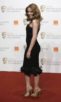 Kylie Attends 62nd BAFTA's